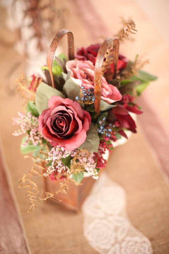 Floral arrangment in Rustic Handbag tin